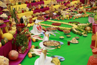 The tilak chandlo can be seen in the background within the annakut composed of various food items