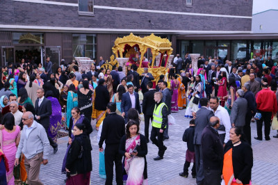 Hundreds of disciples and visitors fill the within the complex outside Shree Swaminarayan Mandir Kingsbury