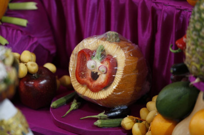 One of the many strange characters crafted by disciples using fresh fruit and vegetables