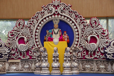 Divine darshan of Lord Shree Swaminarayan, Jeevanpran Shree Abji Bapashree and Jeevanpran Shree Muktajeevan Swamibapa seated on the stage inside Shree Purushottam Mahal