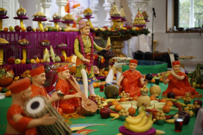 Part of the annakut display potrays sants playing various musical instruments and singing devotional songs to please the Lord