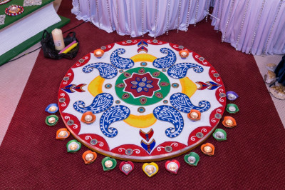 One of the many colourful and intricate rangoli designs