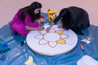 Disciples create a rangoli design
