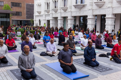 Sants and disciples perform yoga as part of the first International world yoga day