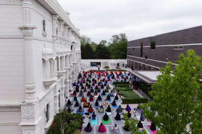 Sants and hundreds of disciples perform yoga celerating the first international world yoga day within the peaceful setting of Shree Muktajeevan Swamibapa Complex