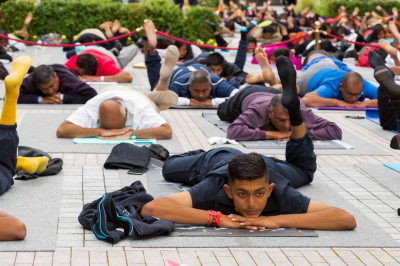 Sants and disciples perform yoga celerating the first international world yoga day within the peaceful setting of Shree Muktajeevan Swamibapa Complex