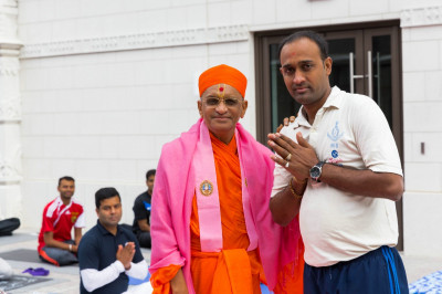His Divine Holiness Acharya Swamishree blesses the yoga instructor