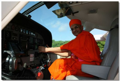 Acharya Swamishree in the cockpit