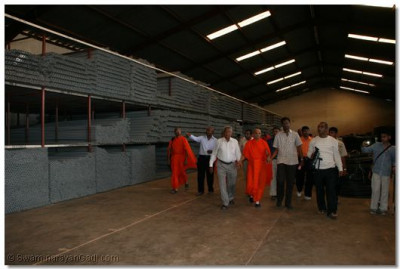 Acharya Swamishree takes a walk in the factory