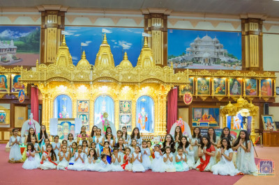 Young devotees pose for a group photo