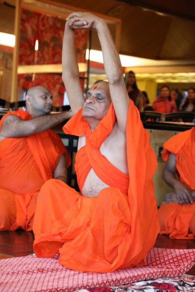 Acharya Swamishree does yoga as part of His morning niyams
