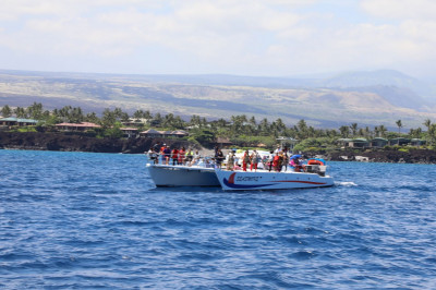 Another boat with disciples sails into the ocean. Beautiful Hawaii is seen in the background