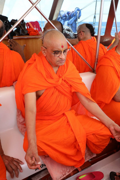 Divine dhyaan leela of Acharya Swamishree on the boat sailing out on the Pacific Ocean