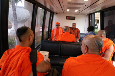 Acharya Swamishree, sants, and disciples seated on the tram to go to the day's volcano excursion