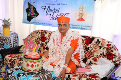 Divine darshan of Acharya Swamishree in hand-made flower vagha. Disciples from Shree Swaminarayan Temple Los Angeles wrote �Happy Birthday� and �Swaminarayanbapa Swamibapa� five times on each and every flower. There were a total of 750 flowers used to make the vagha