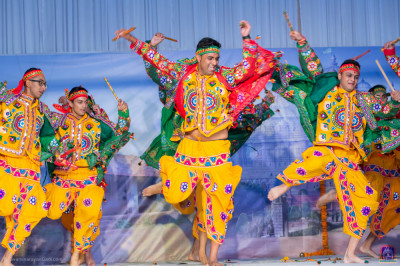 Young disciples perform an energetic dandia devotional dance