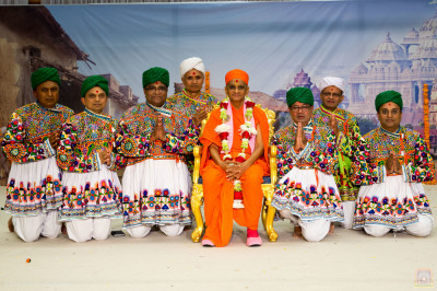 His Divine Holiness Acharya Swamishree blesses disciples who performed the dandia devotional dance