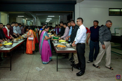 Devotees enjoy the consecrated food