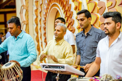 Devotees play various musical instruments