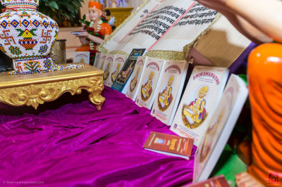 Various Shikshapatri publications at the divine lotus feet of the Lord