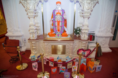 The completed cards are placed at the divine lotus feet of the Lord