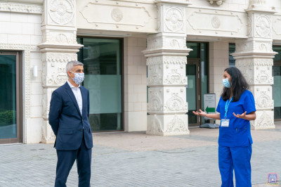 Darshna Patel - Vaccine Programme Manager for Shree Swaminarayan Mandir in Kingsbury guides London Mayor Sadiq Khan through the vaccine centre