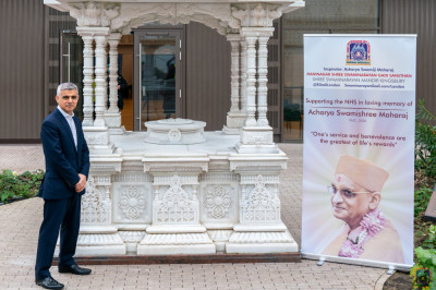 London Mayor Sadiq Khan at the umbrella housing the divine lotus feet of the Lord outside Shree Purushottam Mahal that has been transformed into a vaccine centre in loving memory of Acharya Swamishree Maharaj