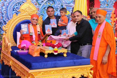 His Divine Holiness Acharya Swamishree Maharaj officially releases the new publication
