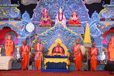 Divine darshan of His Divine Holiness Acharya Swamishree Maharaj seated on stage