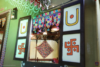 The colourful wall decorations forming the village house