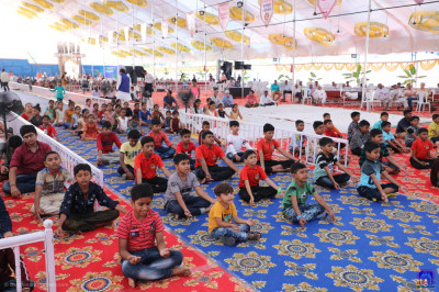Young disciples perform dhyaan taking part in the shibir