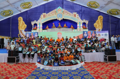 All young disciples who took part in the shibir are presented with school bags