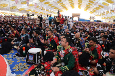 Members of all five international Shree Muktajeevan Swamibapa Pipe Bands seated in the grand assembly