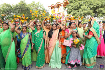 Disciples carry various flowers during the procession