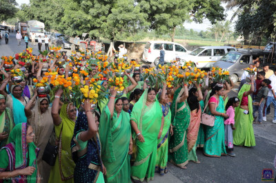 Disciples wear shades of green and carry flowers during the grand procession to please the Lord