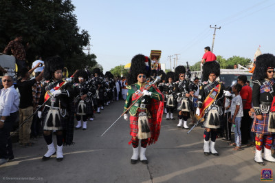 Shree Muktajeevan Swamibapa Pipe Band Bolton and USA march and perform leading the grand procession