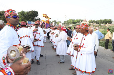 Disciples dressed in white village wear perform devotional songs to please the Lord