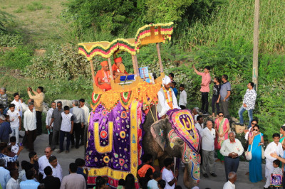 The wonderful scene of sants riding on the elephant with the divine Vachanamrut scripture during the grand procession