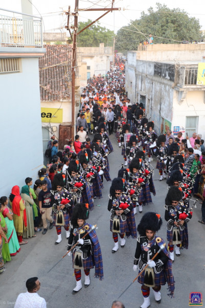 Shree Muktajeevan Swamibapa Pipe Band India perform in three flanks marching through the narrow winding village streets