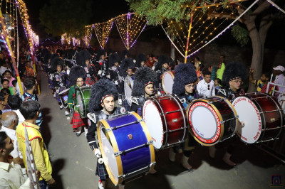 The base drums of all Shree Muktajeevan Swamibapa Pipe Bands perform side by side