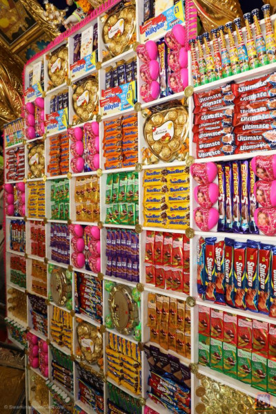 The huge array of confectionary offered to the Lord